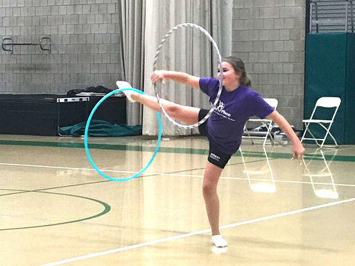 Sixth grader ''leads like a girl'' as she shares her hula hoop skills with her P.E. class