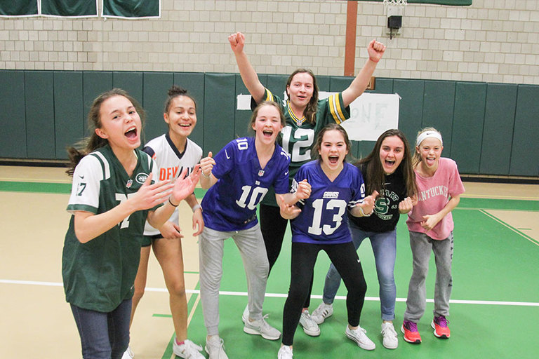 Video: Eighth graders test teachers' endurance in a Super Bowl flag football face-off