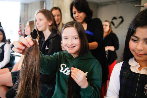 Stuart girls give the a Valentine's Day gift of hair for Locks of Love