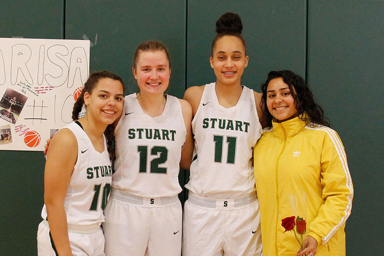 Varsity basketball team bids farewell to its graduating teammates on Senior Day