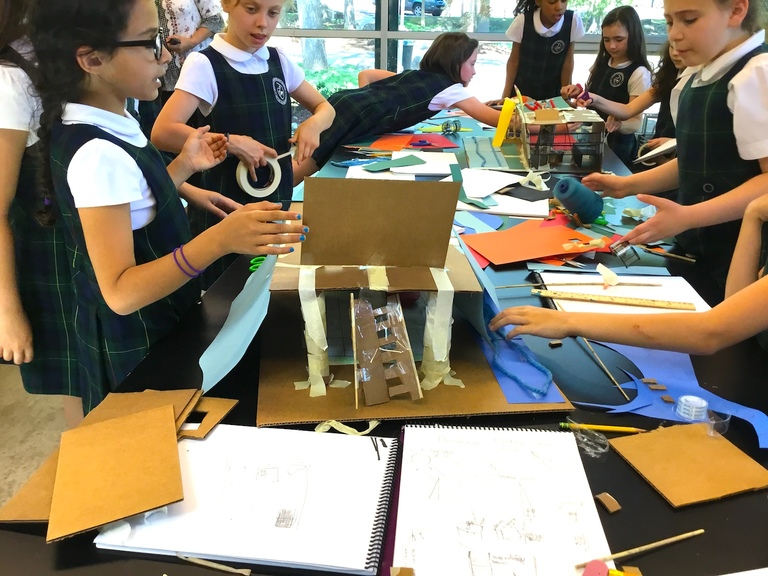Fourth graders learn the value of teamwork and communication through architecture project in art class