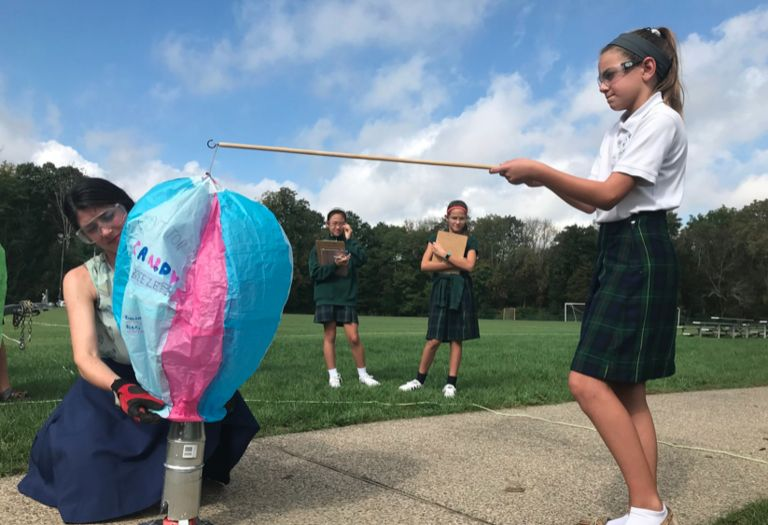 Up, up and away! Sixth grade scientists launch handmade hot air balloons