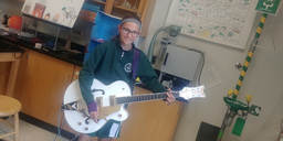 Let's rock! Middle School Guitar Club plays one of the most desired electric guitars around