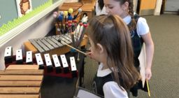First graders experience the synergy of STEM and music by collecting data from instruments and learning from Princeton Symphony Orchestra