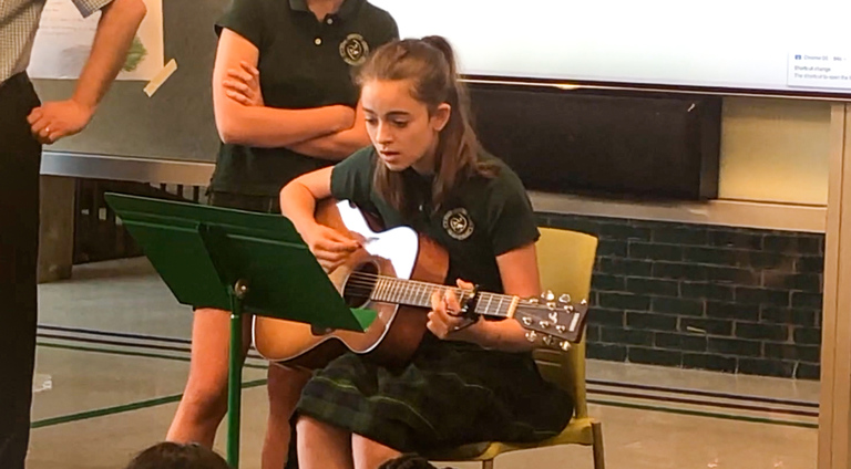 VIDEOS: Middle School students entertained by seventh grade guitar demonstrations
